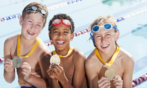 Boys with swimming medals