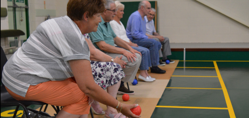 Group of people playing bowls