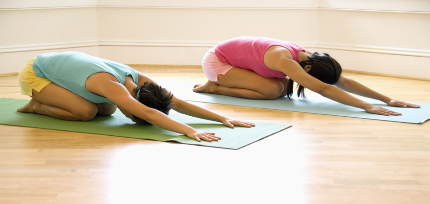 two ladies doing yoga stretch